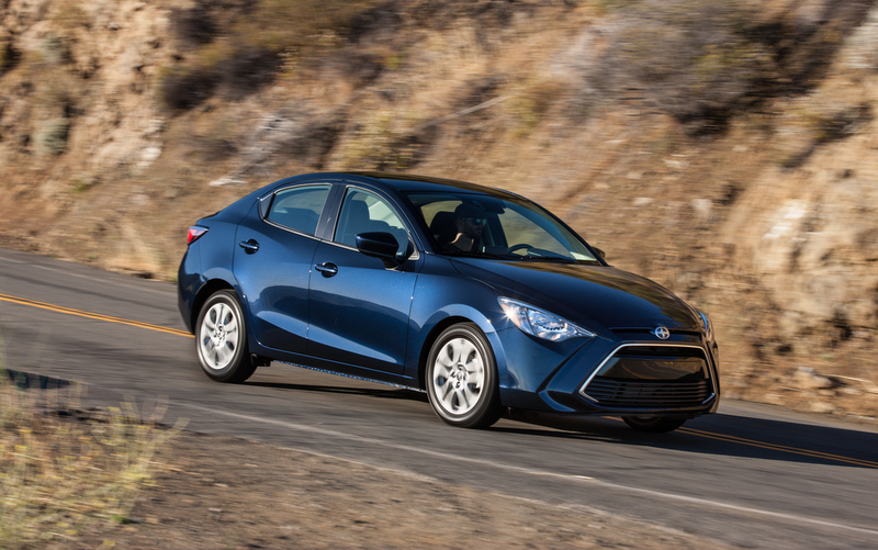 2016 Scion iA sedan manual front 3-4 Mazda2 featured